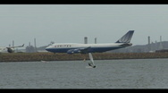 Stock Video Footage of Busy Airport Aircraft taxiing and Landing