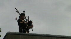 Rooftop piper Stock Footage