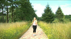 Girl playing  sports, she runs on the way to park - stock footage