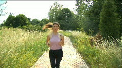 Girl playing  sports, she runs on the way to park Stock Footage