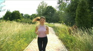 Stock Video Footage of Girl playing  sports, she runs on the way to park