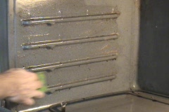 Oven Walls Being Cleaned Stock Footage