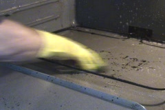 Oven Being Cleaned With Gloves On Stock Footage