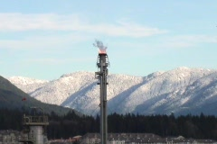 Flame On A Distillery Tower Stock Footage
