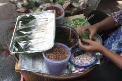 Street Vendor In Bangkok Making A Thai Snack - Mian Kham Stock Footage