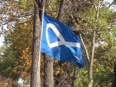 Stock Video Footage of The Blue Metis Flag Blowing in The Wind