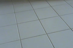 Mopping a White Tile Floor Stock Footage