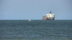 Ocean Scene With Big Ship And Small Vessel (HD 1080p30) Stock Footage
