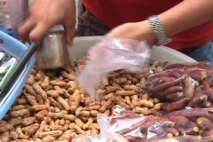 Selling Peanuts on the Street In Bangkok, Thailand Stock Footage