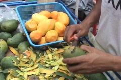 Mangoes Being Peeled By A Street Vendor In Bangkok Thailand Stock Footage