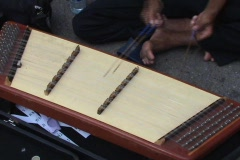 Thai Instrument-Playing The Khim In Bangkok Thailand Stock Footage