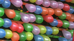 Balloons Popping At An Amusement Park (HD 1080p30) Stock Footage