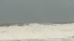 Storm waves crashing on to sandy beach Stock Footage