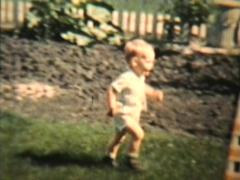 Little Boy Plays With His Grandma 1963 (Vintage 8mm film) Stock Footage