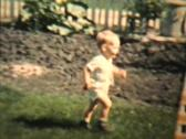 Stock Video Footage of Little Boy Plays With His Grandma 1963 (Vintage 8mm film)