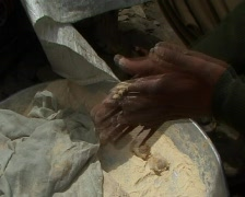 cooking chapati on open fire in India Stock Footage
