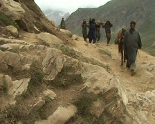 Porters carrying down pilgrims Stock Footage