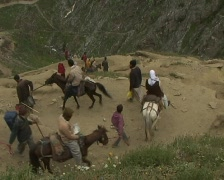 Pilgrims to the holy Amarnath cave in the Himalayas Stock Footage