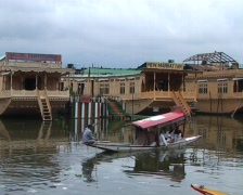 Shikara boats and houseboats on Dal lake in Kashmir Stock Footage