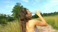 Stock Video Footage of Girl drinks water after playing sports