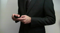 Excited businessman texting - HD  Stock Footage