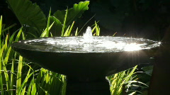 fountain with reflecting sunlight - stock footage