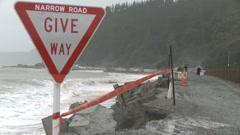 Narrow coastal road erosion Stock Footage