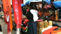 Woman in the Otovalo market Stock Footage