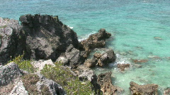 Stock Video Footage of Rocky Caribbean Cliffs in Bermuda with Blue Water and White Sandy Beaches