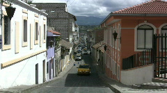 A taxi drives up a street in Ecuador Stock Footage