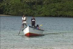 Fiji Men in boat Beqa Stock Footage