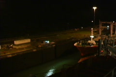 Freighter in locks at night Stock Footage