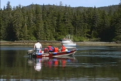 Alaska Skiff approaches boat Stock Footage