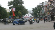 Stock Video Footage of Hanoi traffic with bicycle rickshaws