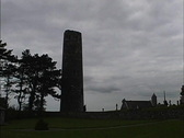 Stock Video Footage of Ireland Backlit tower Clonmacnoise