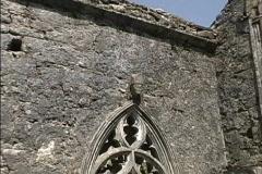 Ireland Stone head on ruined church Stock Footage