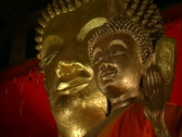 Laos Gold Buddha faces Stock Footage