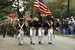 Mardi Gras Flags & troops in parade Stock Footage
