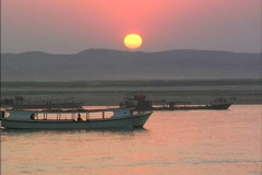 Myanmar Boats at sunset Ayeyarwady River Stock Footage