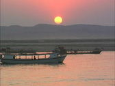 Stock Video Footage of Myanmar Boats at sunset Ayeyarwady River