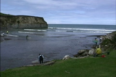 Fishing at mouth of river New Zealand Stock Footage