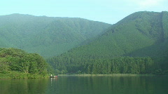 Rural Lake and Mountains on Calm Summer Day Stock Footage