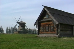 Russia Wooden house & windmill Stock Footage
