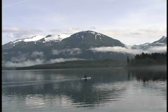 Solitude Kayak and Alaska mountains Stock Footage