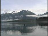 Solitude Kayak and Alaska mountains Stock Footage