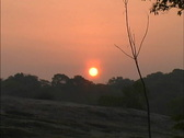 Sunrise in hazy sky Stock Footage