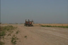 Men on tractor-pulled cart Stock Footage