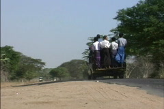 Transportation Truck passes bus Myanmar - stock footage