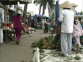 Girls run in Hoi An market Stock Footage