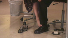 Infatuation at the workplace with leg work - 2 Stock Footage